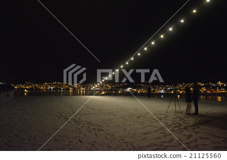 Ship deck with snow and night view of port village Chervoy Northern Europe Norway 21125560