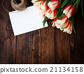 bouquet of colorful tulips on rustic wooden board 21134158