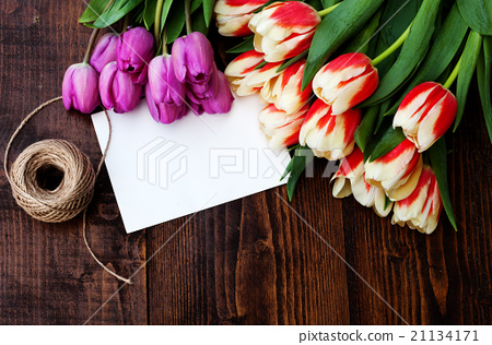 bouquet of colorful tulips on rustic wooden board 21134171