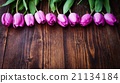 bouquet of colorful tulips on rustic wooden board 21134184
