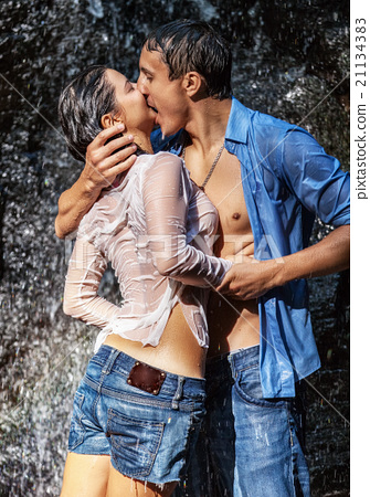 Couple hugging and kissing under waterfall stock photo 21134383 couple hugging and kissing under waterfall altavistaventures Gallery