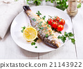 plate of baked sea bass 21143922