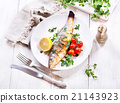 plate of baked sea bass 21143923