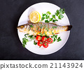 plate of baked sea bass 21143924