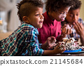 Kids eat cake with hands. 21145684