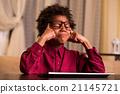 Upset black boy at keyboard. 21145721