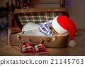 Afro kid sleeping inside suitcase. 21145763