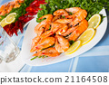 Delicious Mediterranean seafood shrimps and crawfish close up 21164508