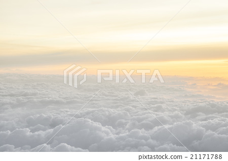 Stock Photo: High above the clouds with beautiful sunset light