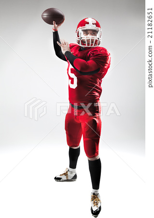 American football player posing with ball on white 21182651