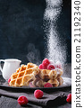Belgian waffles with raspberries 21192340