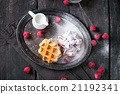 Belgian waffles with raspberries 21192341