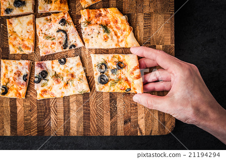Slices of pizza on a wooden board 21194294