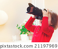 Toddler girl using playing with a camera 21197969