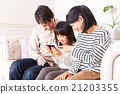 A fashionable three-person family who enjoys movies with smartphones Portrait 21203355