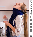 woman in scarf gargling throat with domestic soda 21215954