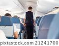 Steward on the airplane. 21241700
