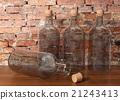 3D rendering glass bottles on wood floor 21243413