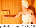 woman relaxing in wooden sauna room 21246734