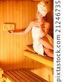 woman relaxing in wooden sauna room 21246735