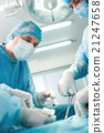 Professional surgical team is doing an operation 21247658