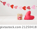 Small giftbox and red heart cushion 21250418