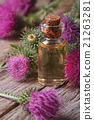 burdock oil in a glass bottle macro vertical 21263281