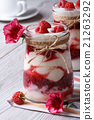 raspberry yogurt on a table decorated with flowers 21263292