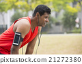 Sporty Indian man resting after urban run. 21272380