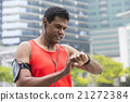 Athletic Asian man using a smart watch. 21272384