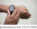 Close up of an Indian man looking at his smartwatch. 21272458