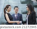Asian business women shaking hands. 21272945