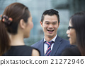Asian Business colleagues talking to each other. 21272946