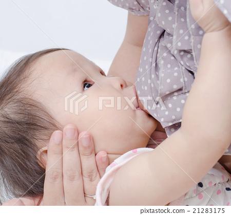 Asian mom breast feeding her baby girl 21283175