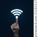 Hand pressing wi-fi button over blue background 21291517