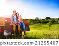 Senior couple sitting in back of red pickup truck 21295407