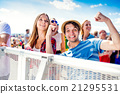 Teenagers at summer music festival, boy showing 21295531