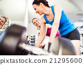 Detail of women in gym working out with weights 21295600