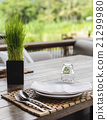 Clean dishes on wooden table on green background 21299980