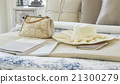 Decorative set with vintage bag,hat,books on bed 21300279