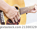 Hand of old man on playing guitar 21300329