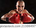 The young man kickboxing on black  with screaming 21306497