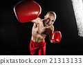 The young man kickboxing on black  with kapa in 21313133