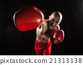 The young man kickboxing on black  with kapa in 21313138