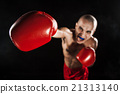 The young man kickboxing on black  with kapa in 21313140