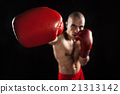 The young man kickboxing on black  with kapa in 21313142