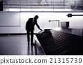 Businessman picking up suitcase on luggage 21315739