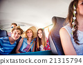 Teenage boys and girls inside an old campervan 21315794