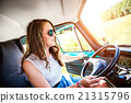 Hipster teenage  girl inside an old campervan 21315796