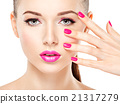 eautiful woman face with pink makeup of eyes and nails. 21317279